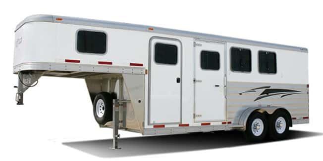 White Featherlite gooseneck orse trailer