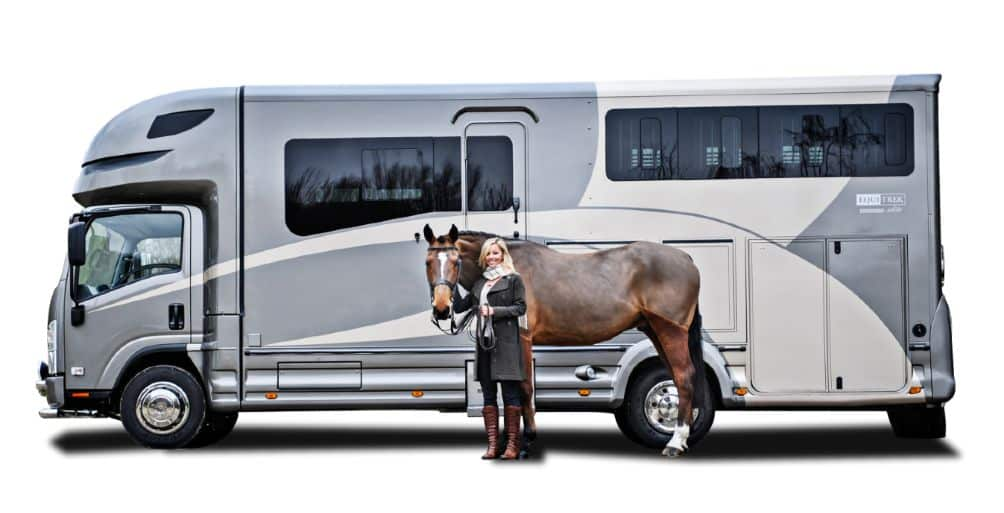Horsebox hire and rental with a woman holding a horse