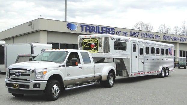 Pick up truck towing a Gooseneck horse trailer