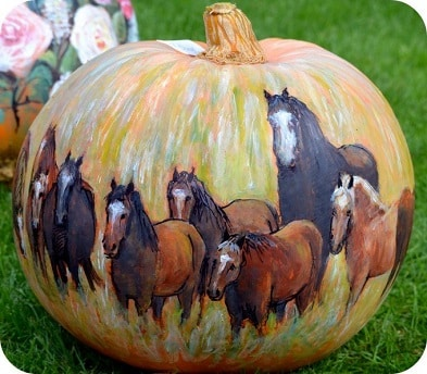 Herd of horses painted on a pumpkin