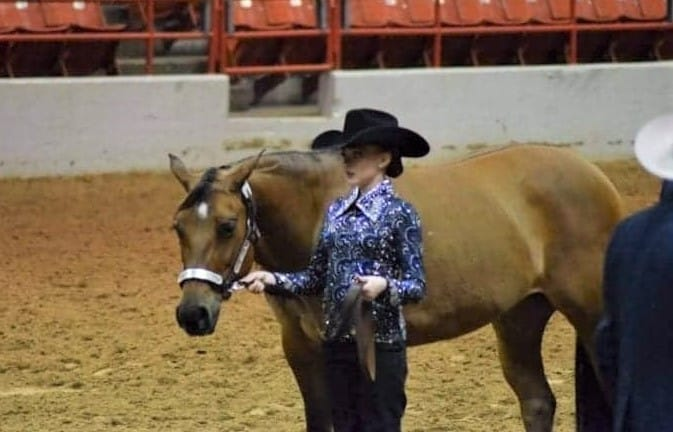 Amber Keller with her rescue horse Molly at the winners podium