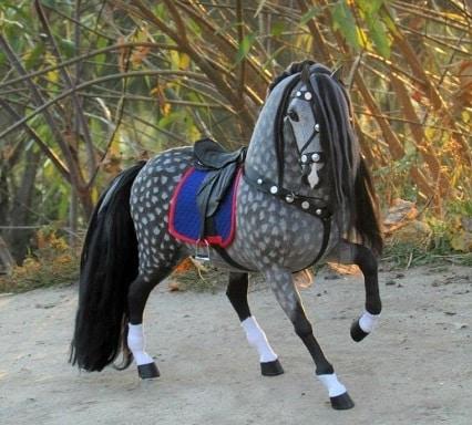 Dapple grey horse with tack