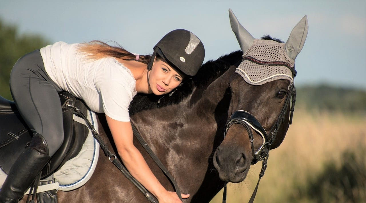 Horse and girl bonding together - Ways to build trust with your horse