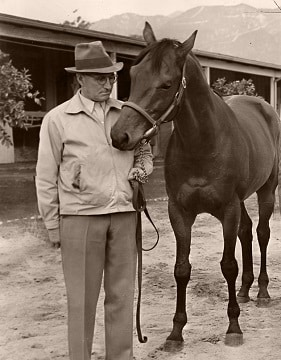 Seabiscuit with his trainer Tom Smith