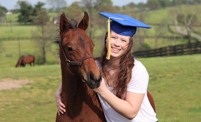 Student at the University of Kentucky hugging a horse