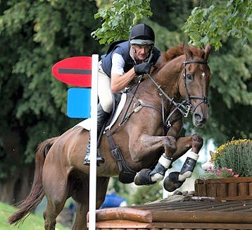Mark Todd riding and jumping on a horse