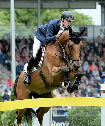 Hello Sanctos horse jumping a competition fence