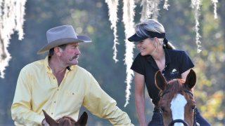 Pat and Linda Parelli famous natural horsemanship trainers riding on horses