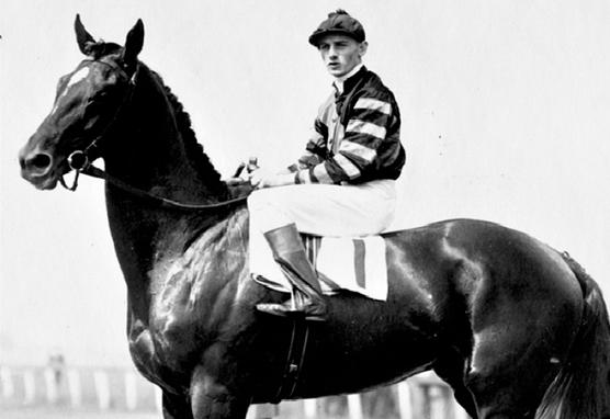 Jockey Earl Sande riding Man o' War