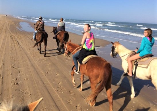 Horse riding on a beach on South Padre Island, Texas