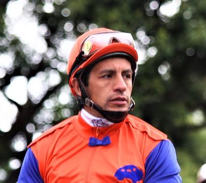 Jockey Victor Espinoza on a race horse before a race