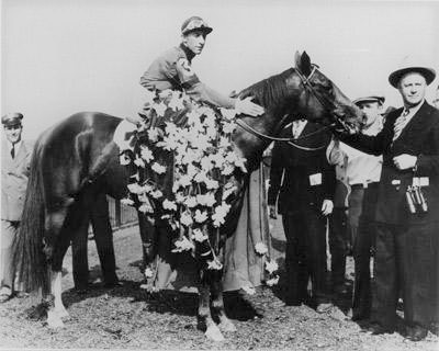 Whirlaway race horse after winning a race