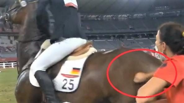 German modern pentathlon coach hitting horse