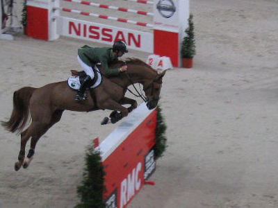 Baloubet Du Rouet jumping in a show jumping competition