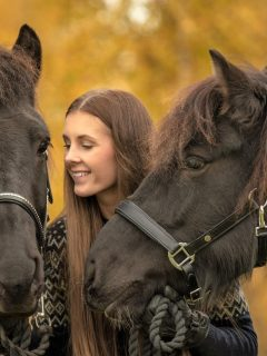 Is horse riding cruel? A girl holding two horses
