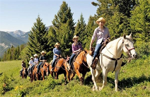 Horseback riding trek at Triple J Wilderness Ranch in Montana
